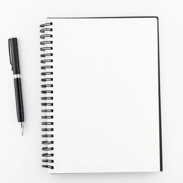 widok z góry, pusty notes na białym tle. - notes zdjęcia i obrazy z banku zdjęć