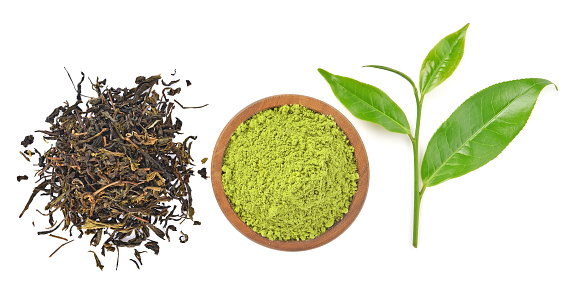 Top view f powder green tea and green tea leaf isolated on white background