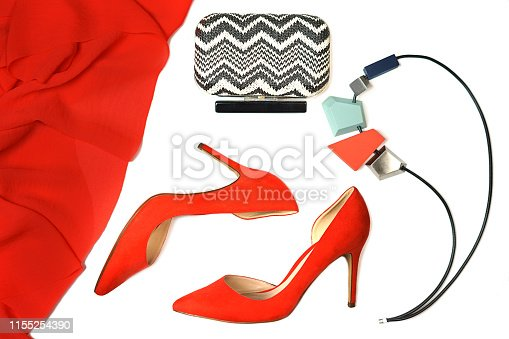 Top view female party outfit red coral shoes accessories jewelry clutch on white background isolated. Party date Valentine's Day Christmas Happy New Year wedding dinner set conception. Flat lay, copy space.