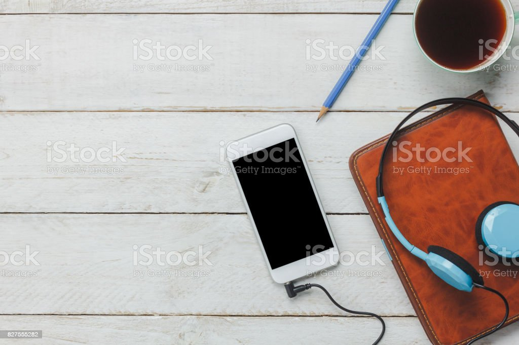 Best Music Coffee Table Books.Top View Flat Lay The Pen Note Book White Mobile Phone Listening