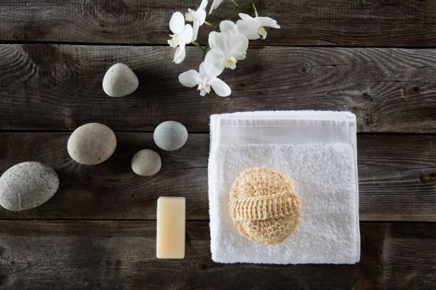 top view for detox spa with loofah and zen symbols - peeling bürste stock-fotos und bilder