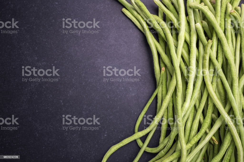 Top view fresh green cowpea or Asparagus bean on black stone - Royalty-free Agriculture Stock Photo