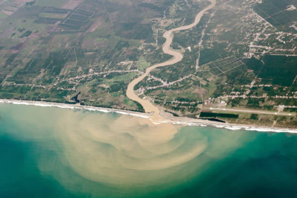 top view from air, a bird's eye of the river with muddy water, flowing into ocean or sea. - boca suja imagens e fotografias de stock