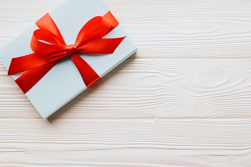 Top view gift boxes on a white wooden background with copy space.