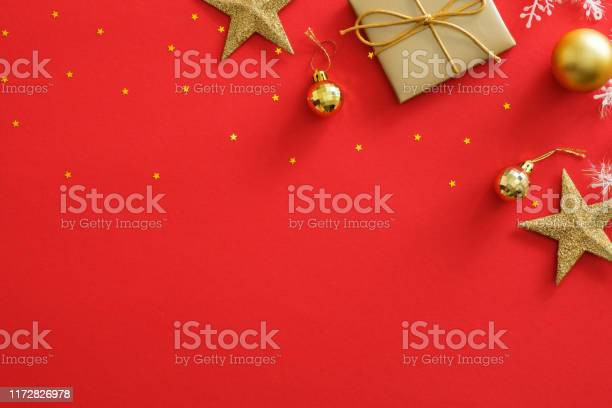 Top view golden christmas decorations on red background flat lay gift picture id1172826978?b=1&k=6&m=1172826978&s=612x612&h=n7lhz0nrimv049xhx6epmvn5gnksmi3dcg6fa47z7u8=