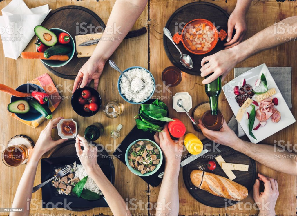 Top view, Group of people sitting at the table having meal stock photo