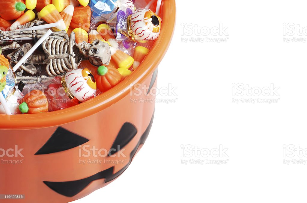 top view halloween pumpkin pail with candy stock photo