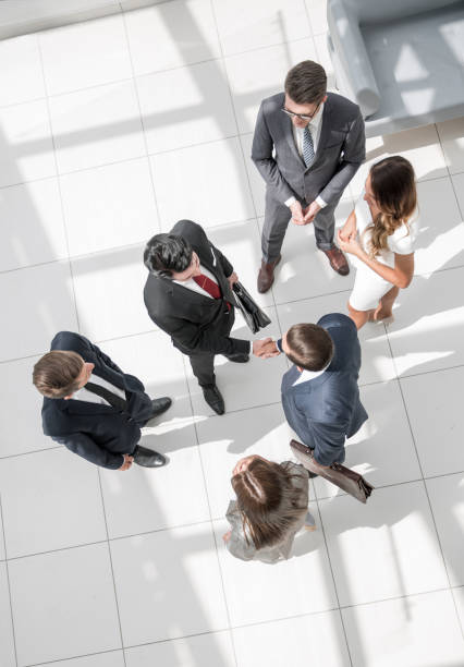 top view. handshake business partners at the meeting stock photo