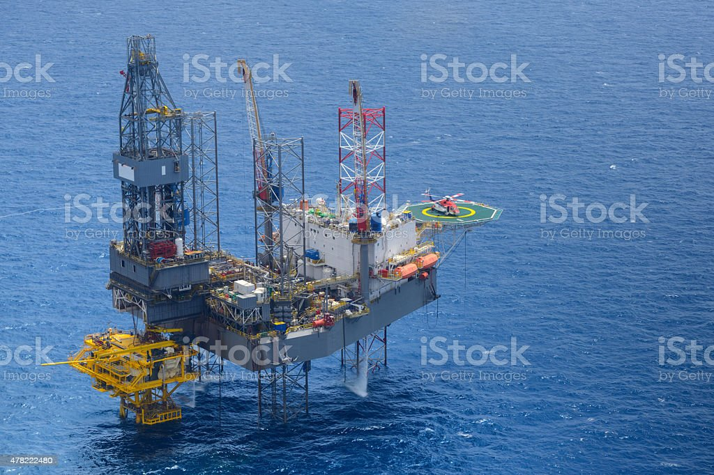 Top view helicopter pick up passenger on the oil rig stock photo