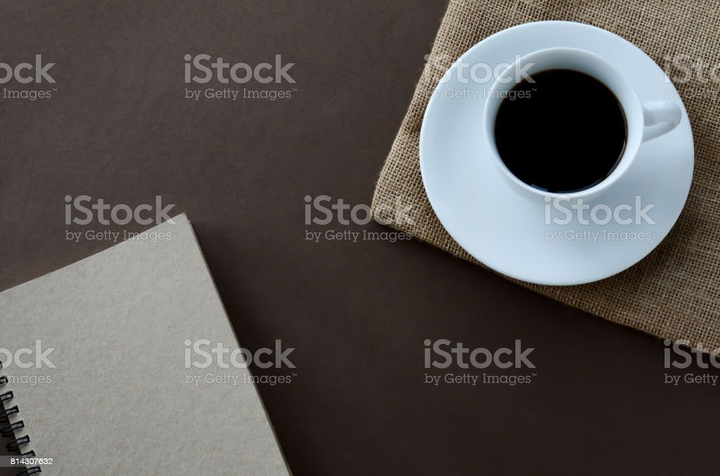 top view hot black coffee and notebook. stock photo