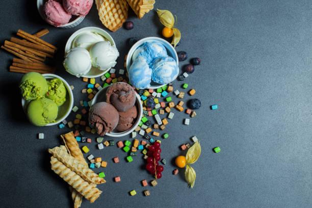 top view ice cream flavors in cup on blackground - coppa gelato foto e immagini stock