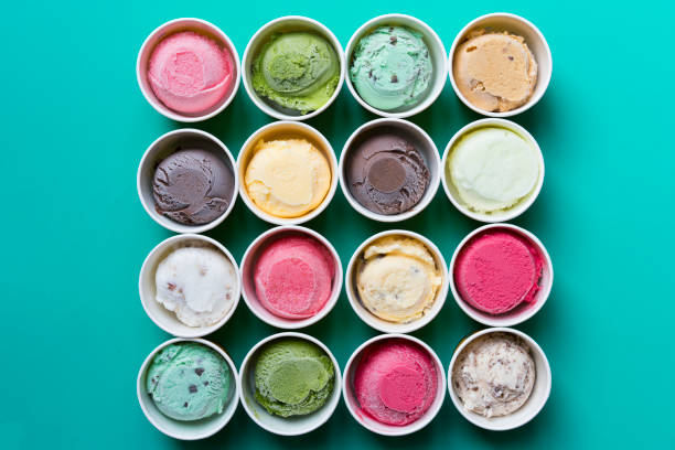 top view ice cream flavors in cup on green background - seasoning stock photos and pictures