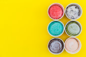 istock Top view Ice cream flavors in cup on yellow blackground 654107874