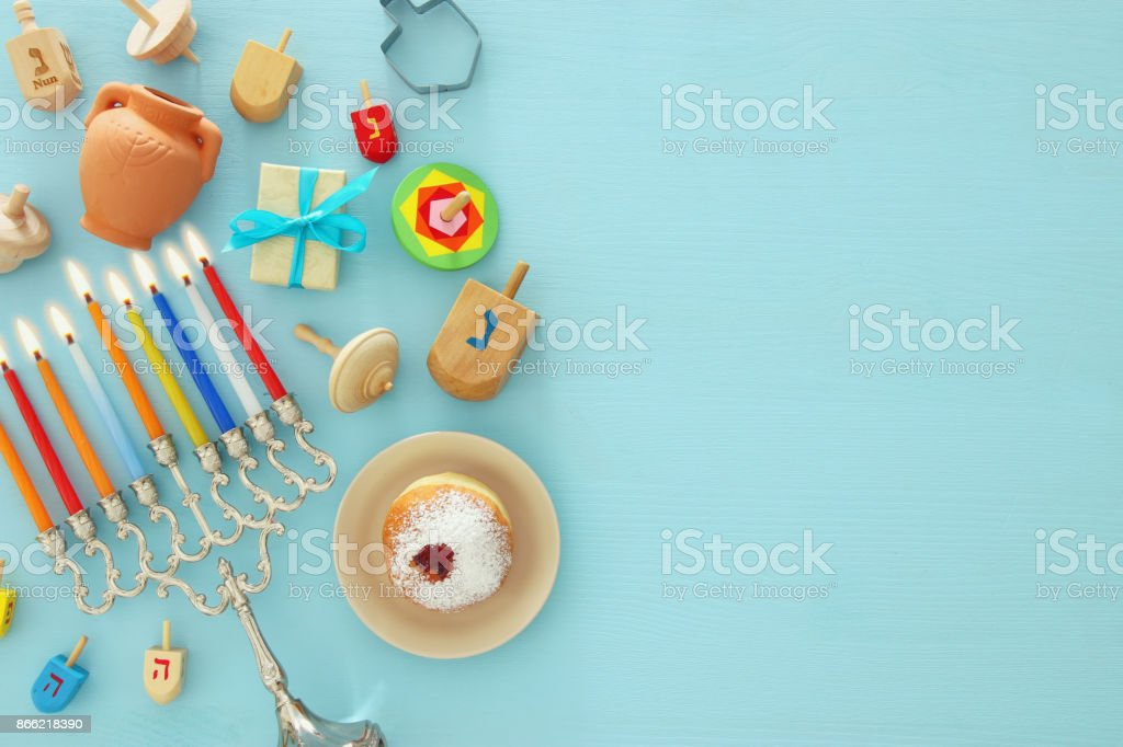 Top view image of jewish holiday Hanukkah background with traditional spinnig top, menorah (traditional candelabra) stock photo