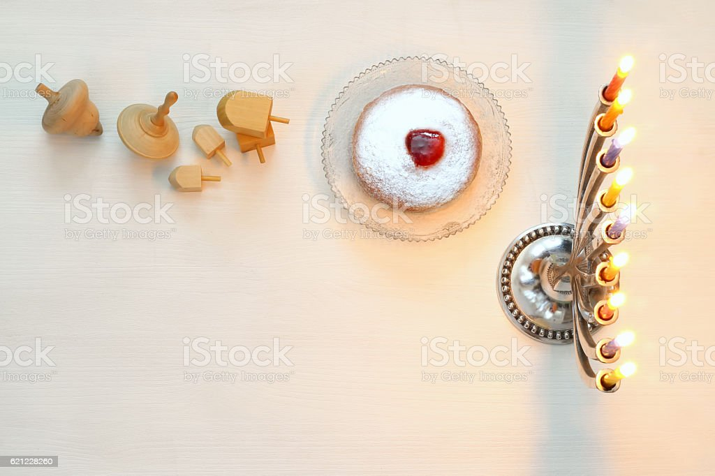 Top view Image of jewish holiday Hanukkah with menorah and wooden...