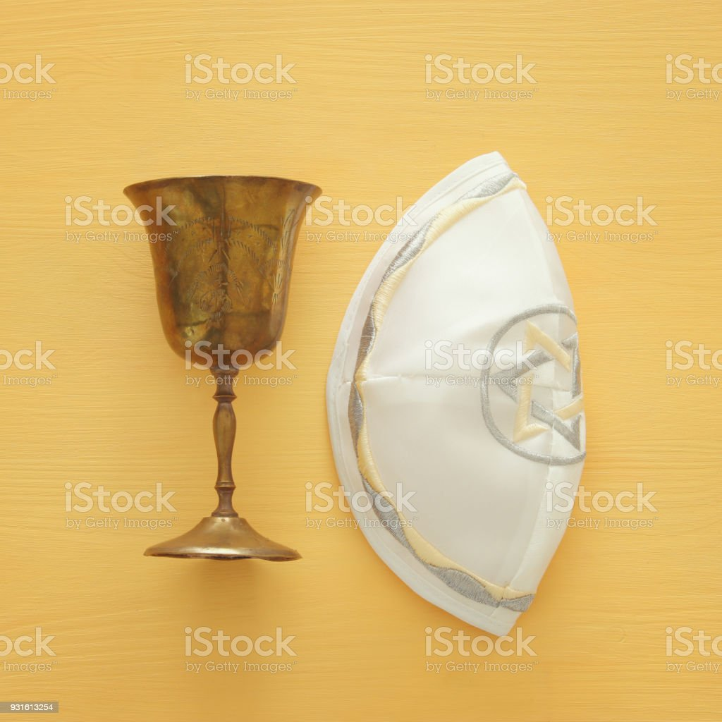 Top view image of jewish wine cup for wine next to kippah yarmulke top view image of jewish wine cup for wine next to kippah yarmulke hat biocorpaavc Gallery