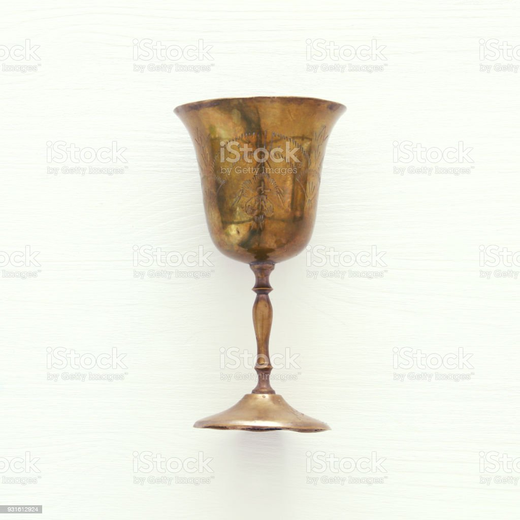Top view image of jewish wine cup for wine. passover holiday and shabbat concept. stock photo