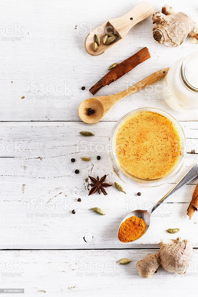 Top view image of turmeric latte and spices stock photo