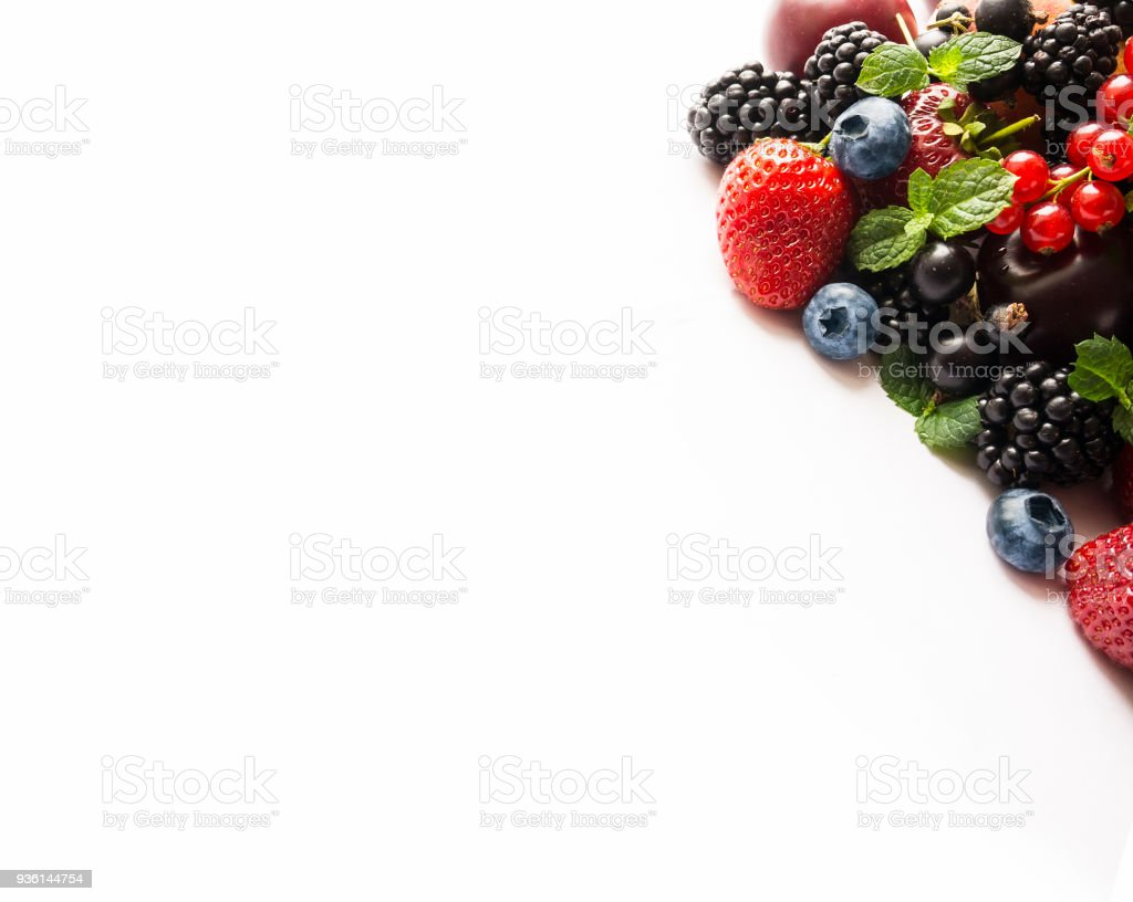 Top view. Mix berries on a white with copy space for text. Ripe blackberries, blueberries, strawberries, red currants on white background. Background berries. Various fresh summer berries. stock photo