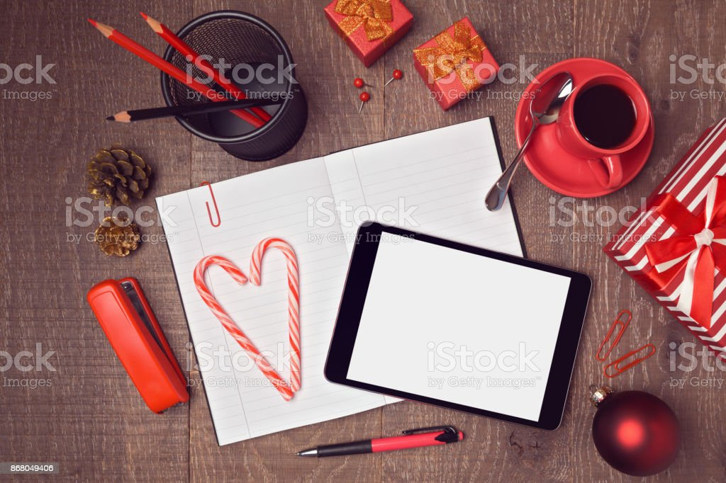 Top view mock up template of desktop for Christmas with digital tablet and gift boxes. Hero header image stock photo