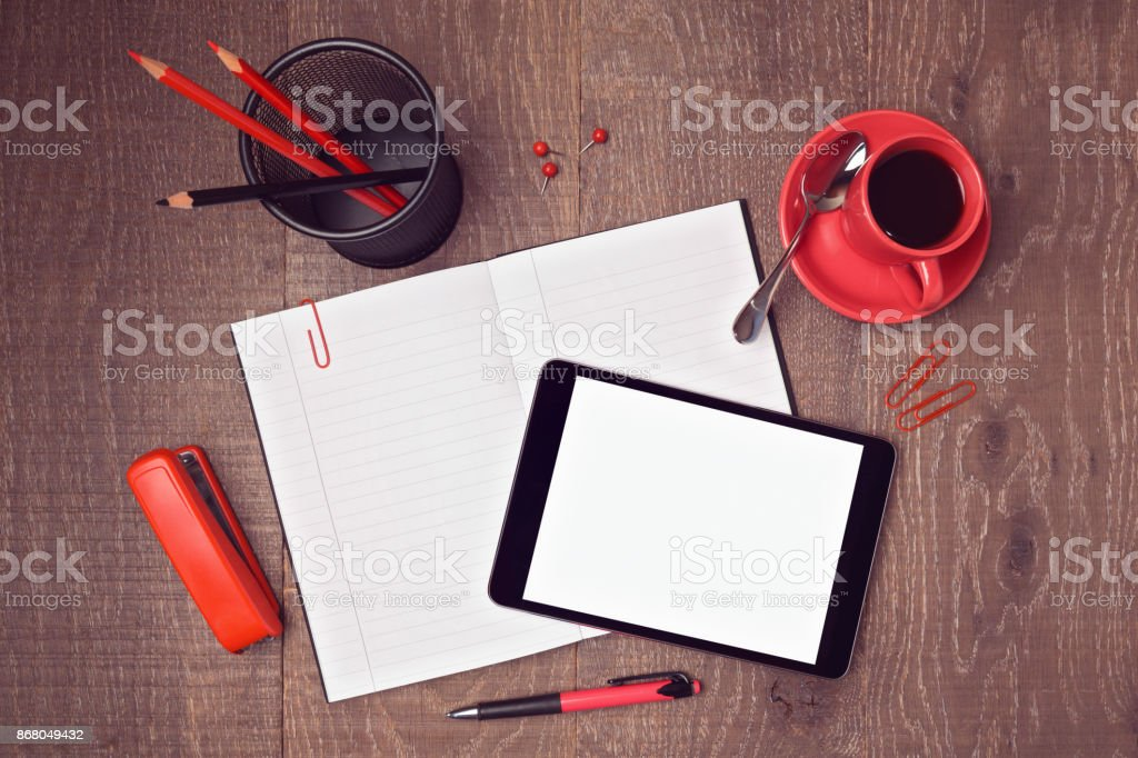 Top view mock up template of office desk with digital tablet and notebook. Hero header image stock photo