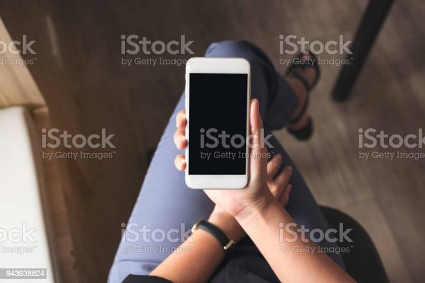 Top view mockup image of a woman holding white mobile phone with picture id943638824?b=1&k=6&m=943638824&s=612x612&h=q9bseiufnff0u4cbry1a9vxfrgamoujbnovl0fwg0vi=