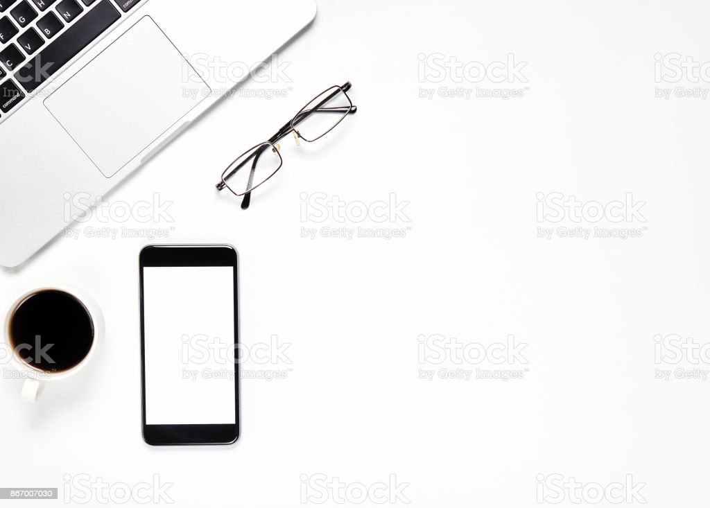 Top view, Modern workplace with laptop and coffee with smart phone placed on a pastel yellow background. Copy space suitable for use in graphics. stock photo