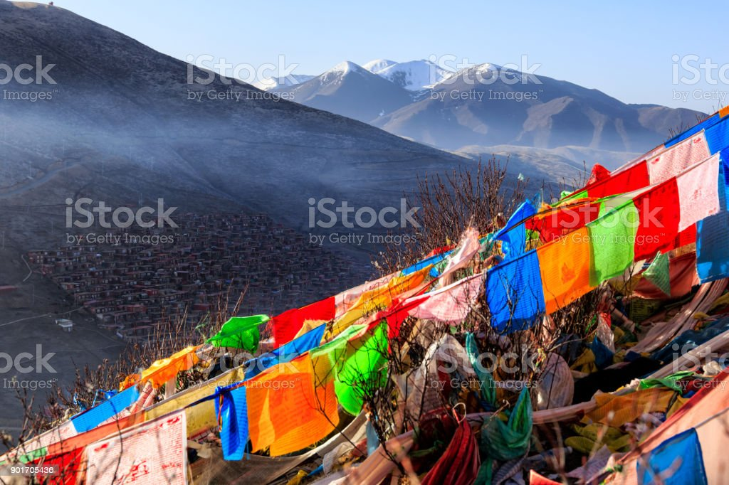 Top view monastery at Larung gar Buddhist Academy in a warm and foggy morning time, Sichuan, China stock photo