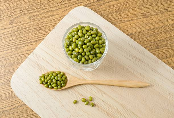 Top View Mung Beans in Spoon and Glass Cup stock photo