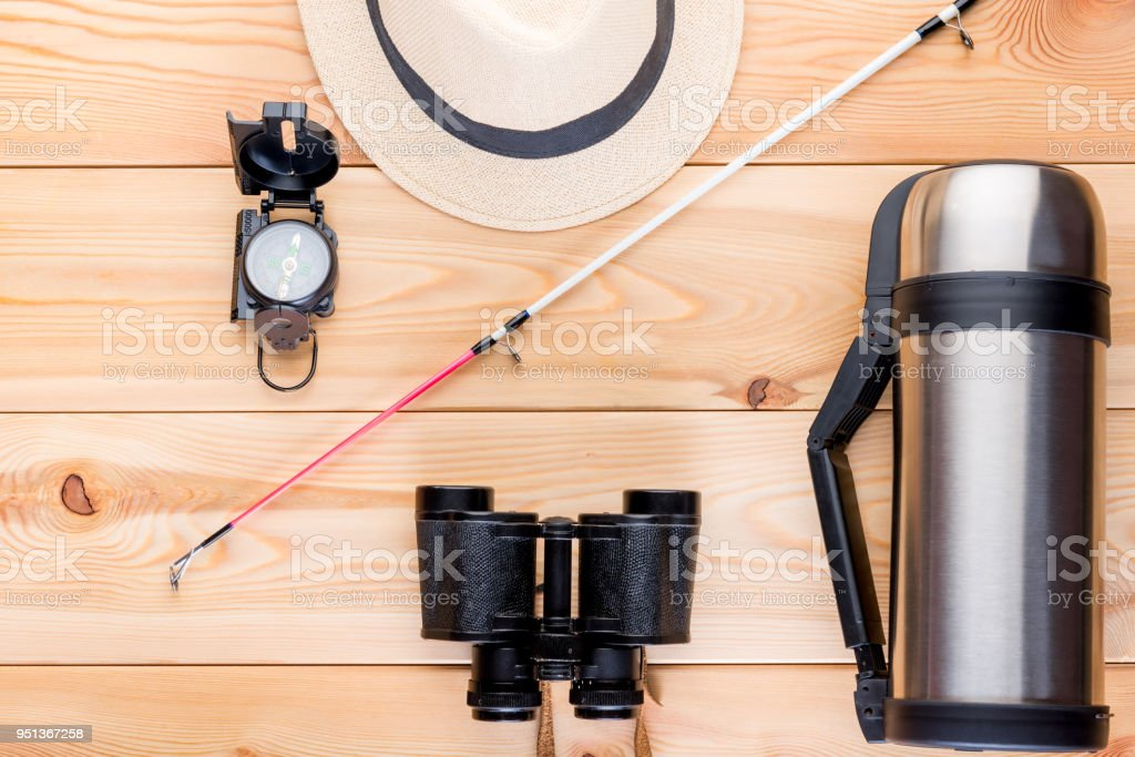 top view objects to search for fish and fishing on the wooden floor stock photo