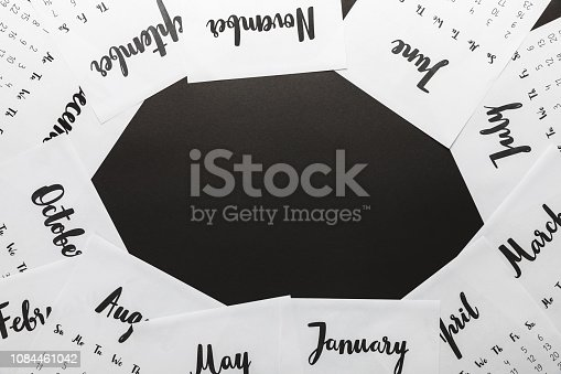 1019268352 istock photo top view of 2019 calendar on black background 1084461042