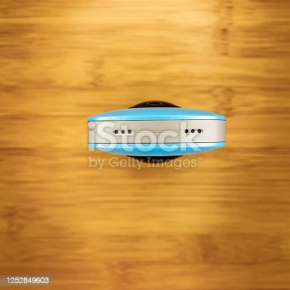 istock top view of a 360 camera gadget kept on wooden surface 1252849603