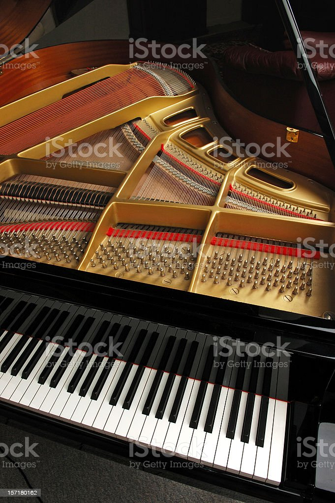 A top view of a baby grand piano with the lid open  royalty-free stock photo