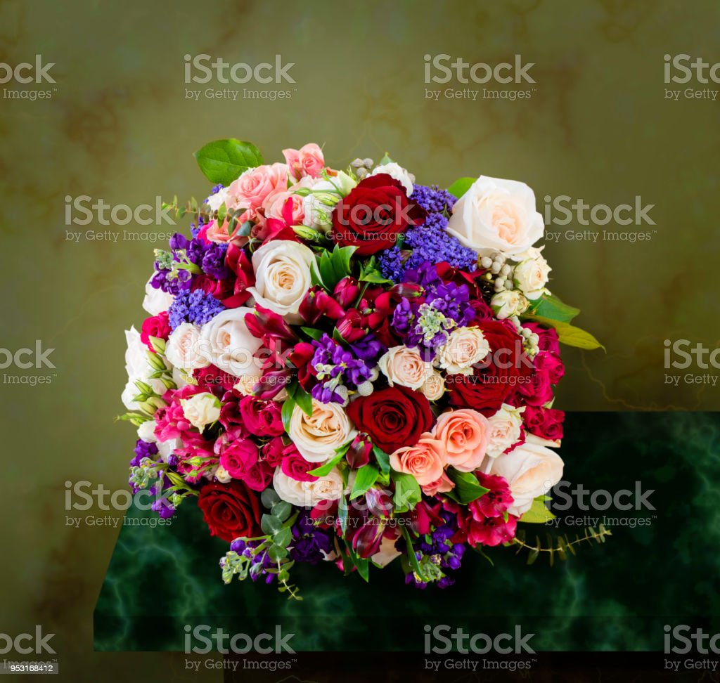 Top view of a beautiful bouquet of flowers multicolored roses with top view of a beautiful bouquet of flowers multi colored roses with green leaves izmirmasajfo