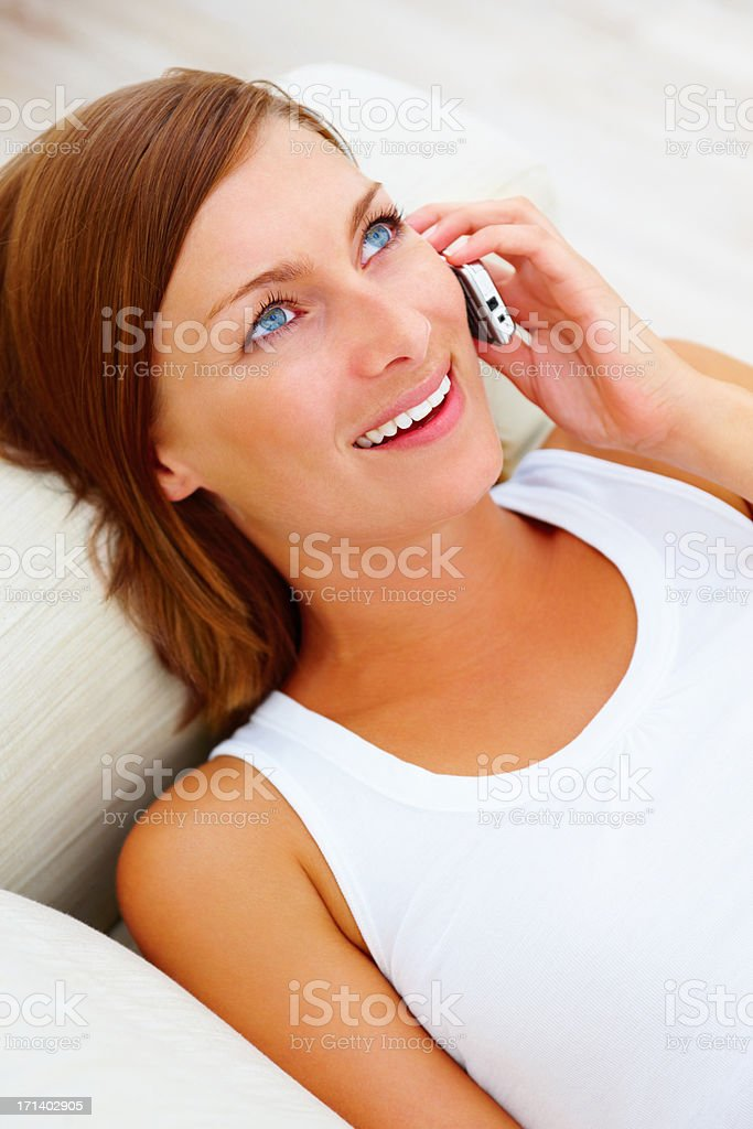 Top view of a beautiful girl talking on a cellphone stock photo