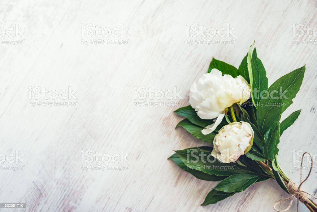 Top view of a bouquet of white peonies flowers over white wooden top view of a bouquet of white peonies flowers over white wooden rustic background copy mightylinksfo