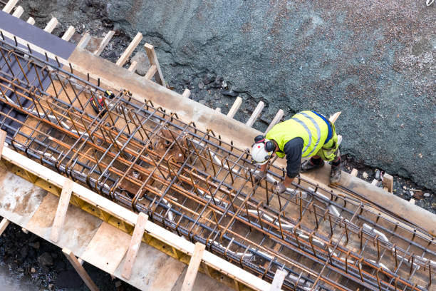 Top view of a builder worker working on a concrete construction under the bridge of Tromso, Norway stock photo