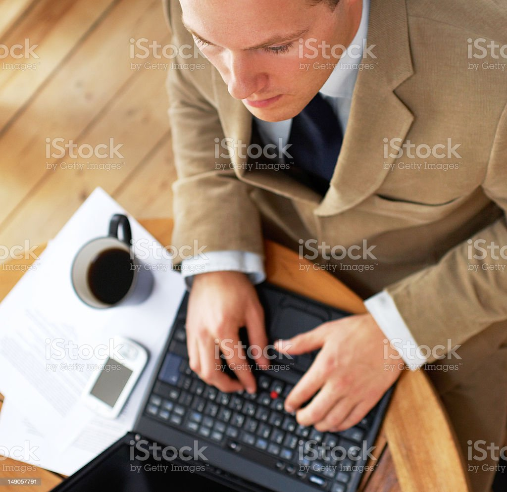 Top view of a business man using laptop royalty-free stock photo