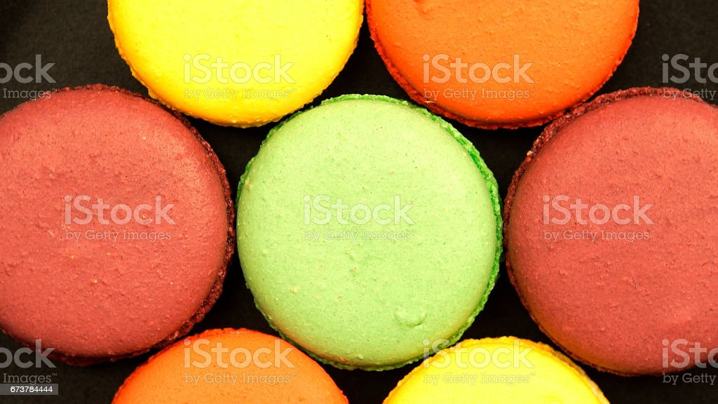 Top view of a Colorful Macaroons on a black table royalty-free stock photo
