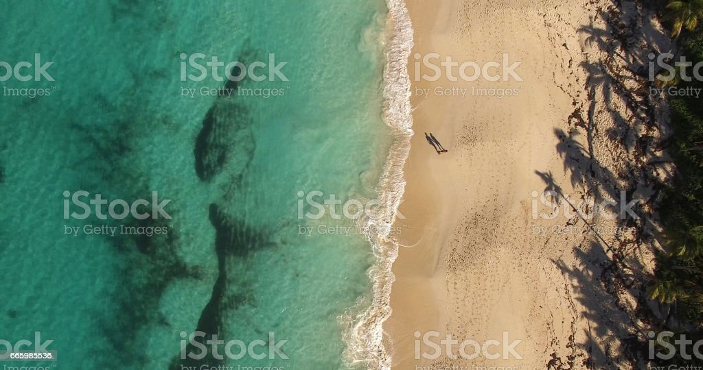 Top View of a Couple Shadow in Paradise Beach, Bahamas stock photo