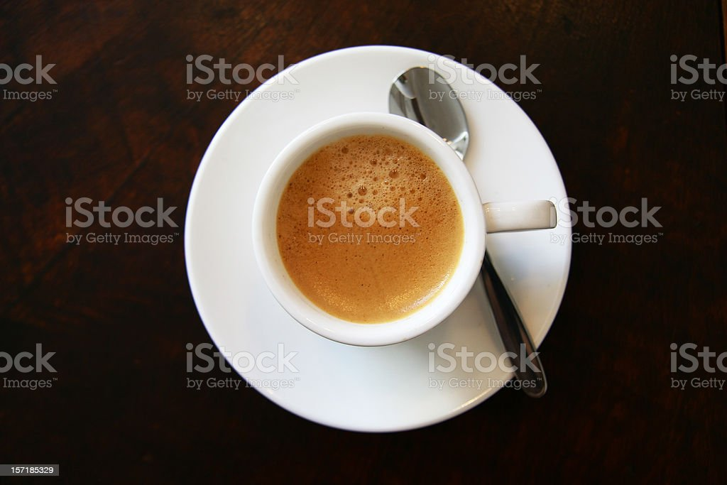Top view of a cup of espresso on a saucer royalty-free stock photo