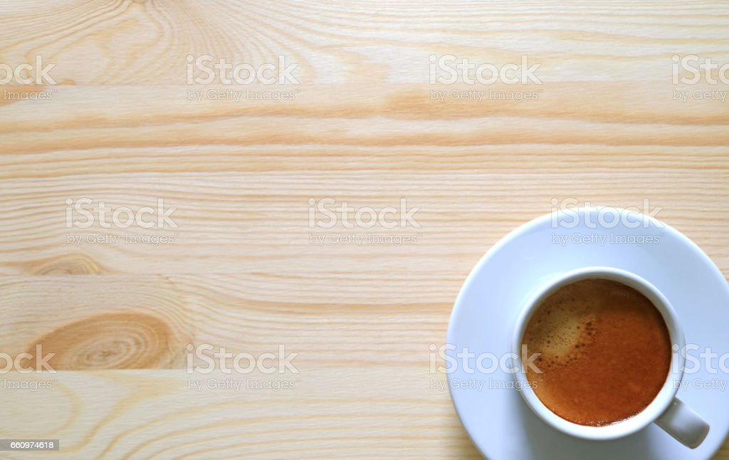 Top View of a Cup of Espresso on the Wooden Table stock photo