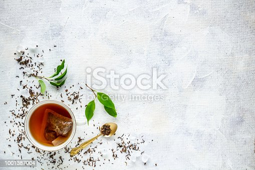 Top view of a cup of tea with tea bag, space for your text