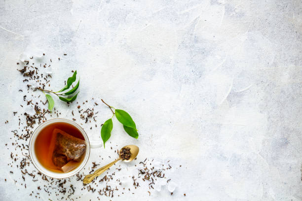 top view of a cup of tea - tea leaf stock photos and pictures
