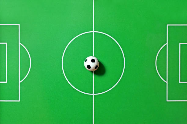 Top View Of A Foosball Table Toy Soccer Ball In Center Of The