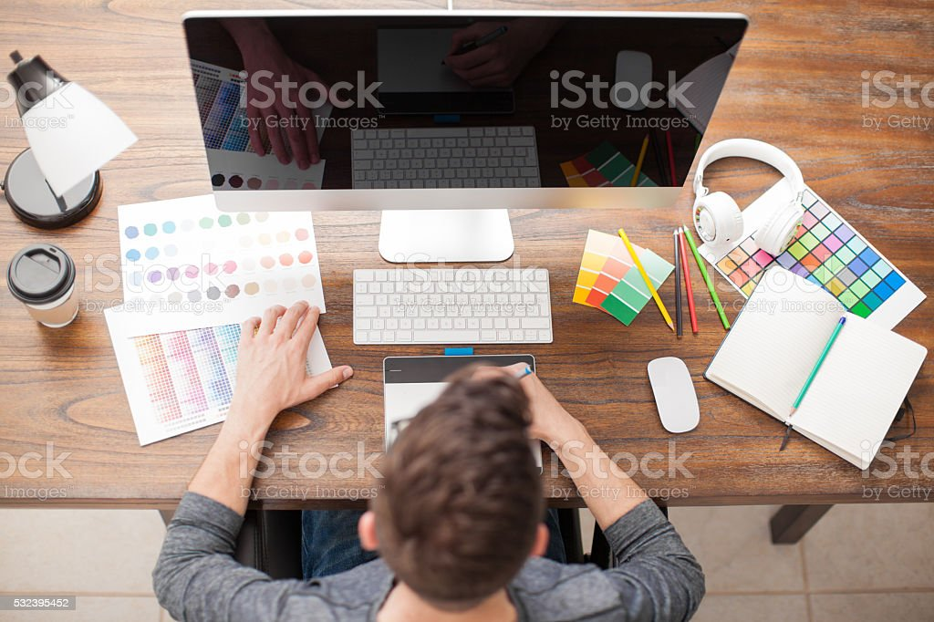 Top view of a graphic designer at work stock photo