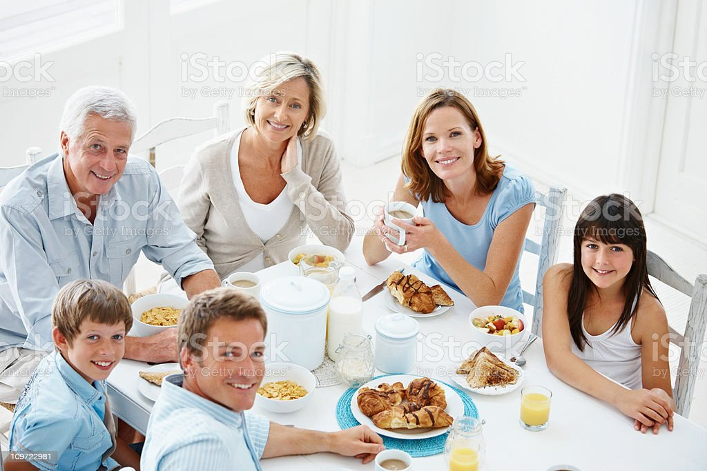 Top view of a happy family having breakfast royalty-free stock photo