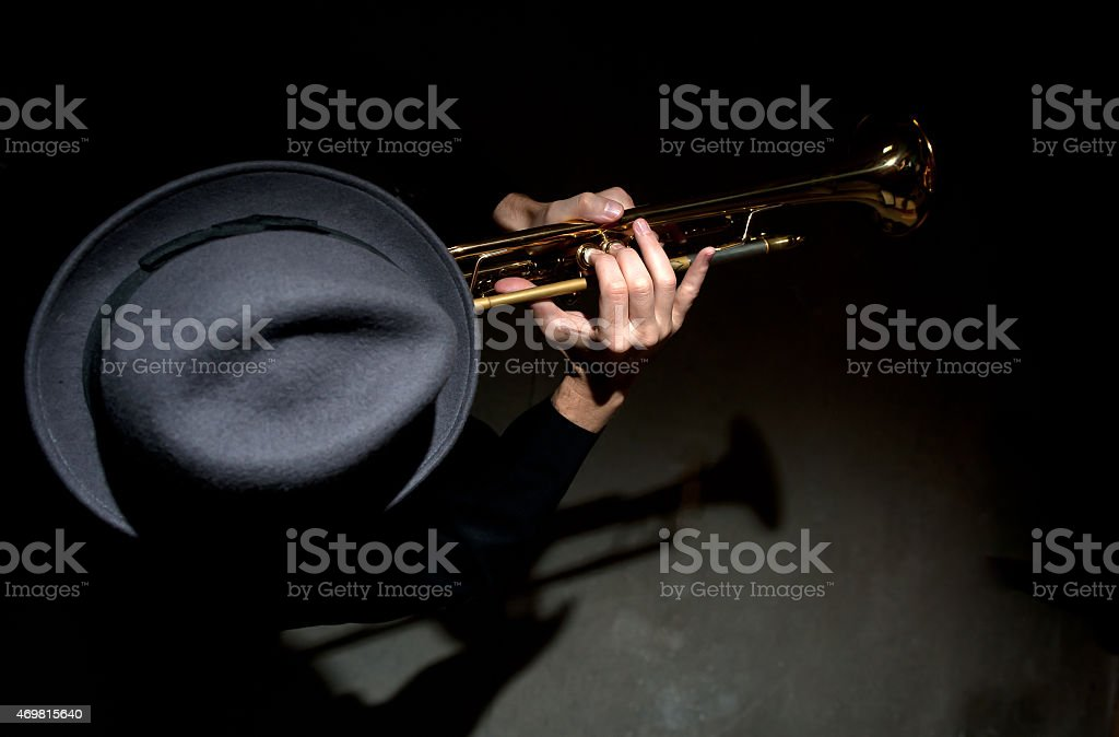 A top view of a Jazz musician playing a trumpet stock photo