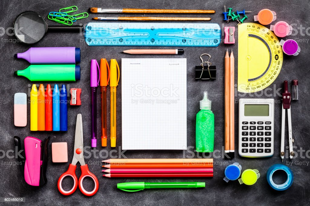 Top view of a large group of school or office supplies on black background stock photo