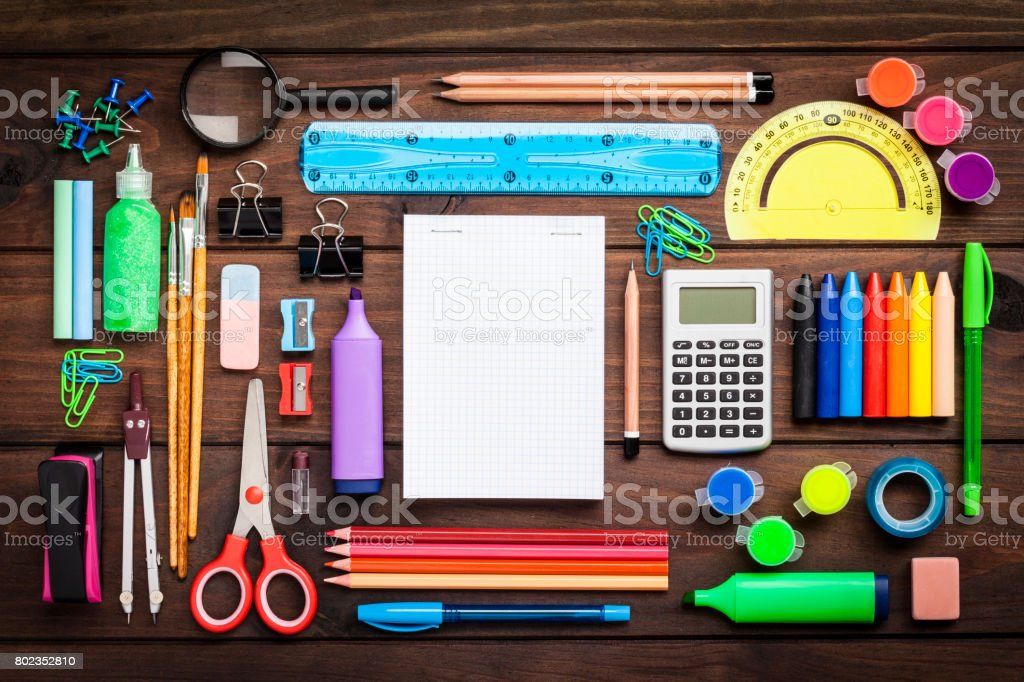 Top view of a large group of school or office supplies on wooden table stock photo